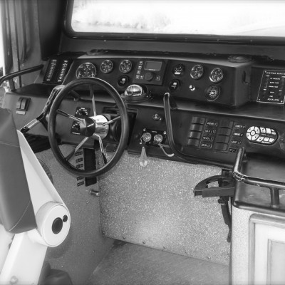 the interior of a boat front controls