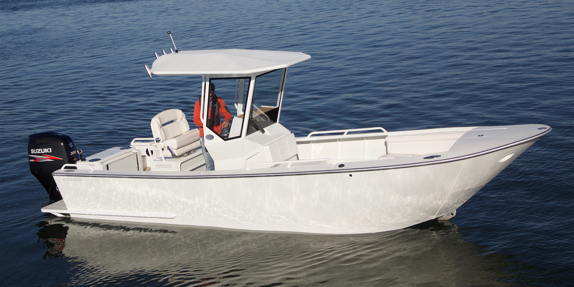 white Moore 25 boat